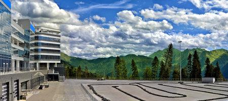carting: Panoramic view of mountains and carting track in Gazprom Laura ski resort in Krasnaya polyana, Sochi, Russia