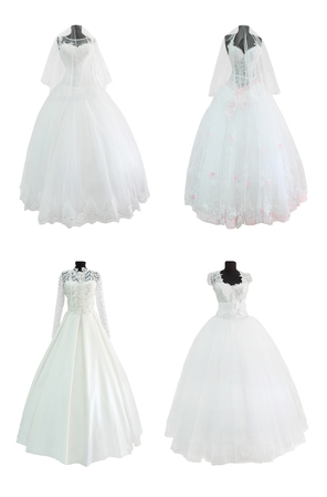 evening gowns: Set of wedding gowns and evening dress on mannequins isolated on white background
