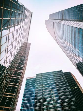 Bottom view of high skyscrapers. Triangular shape Stock Photo