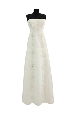 Beautiful white dress with laces, embroidery and beads for wedding or other ceremonies. Women clothes isolated on white background Stock Photo