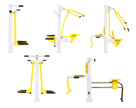 Set of gym machines for legs, chest, back etc. exercising. Side view of fitness equipment isolated on white background