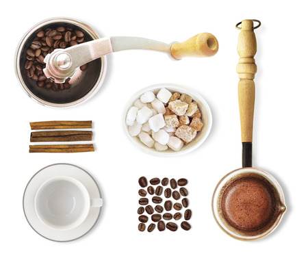 Top view of coffee isolated on white background. Set of coffee beans, turkish jezve, grinder etc. for hot drink preparation and brewing. Foto de archivo