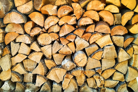 Stacked wooden logs background. Cut tree trunks texture Stock fotó
