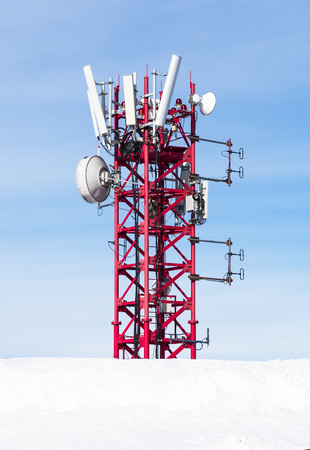 Radio antenna for mobile network at blue sky background