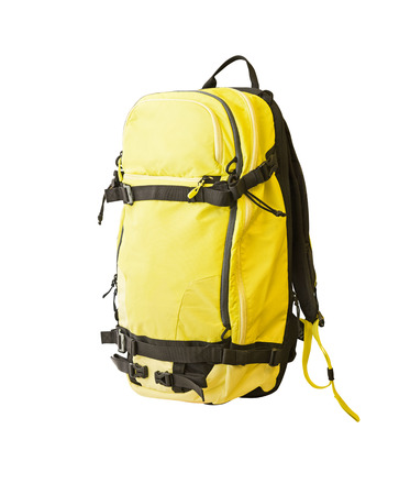 Side view of yellow backpack with straps for trekking, ski tours, hiking, etc. Sport equipment isolated on white background