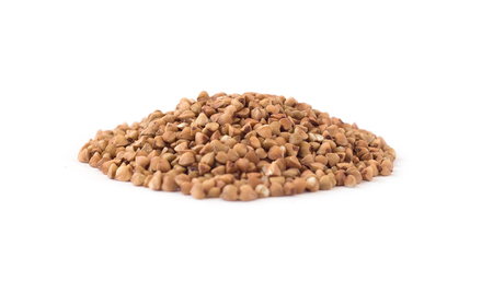 Side view of buckwheat groats heap isolated on white background