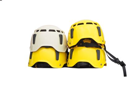 Set of yellow and white helmets isolated. Protective hard hats for extreme sports