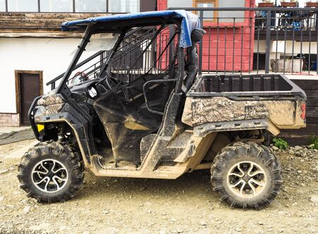 Side view of dirty buggy. ATV vehicle for extreme off-road riding extreme