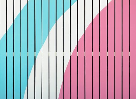 Color wooden fence background. Blue, white and pink colored texture