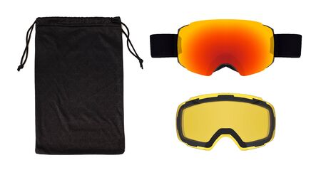 Set of ski goggles, lens and bag isolated on white background