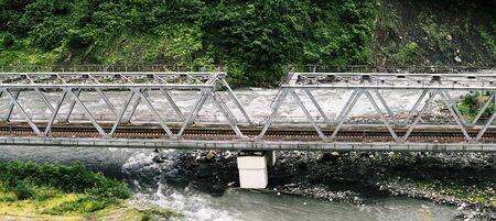 Railroad bridge over river. Construction for railway transport Imagens