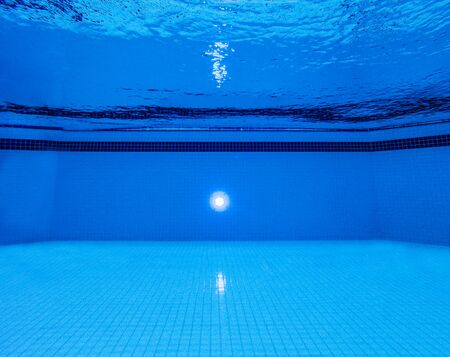 Underwater view of swimming pool and blue water surface with ripples Stock fotó
