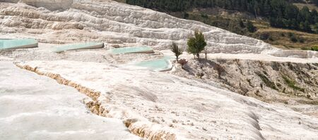 Panoramic view of travertines with blue water in Pamukkale, Turkey Stock fotó