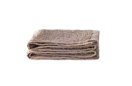 Front view of folded brown towel isolated on white background Stock fotó