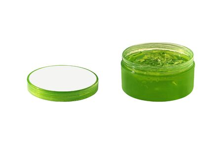 Side view of open aloe vera or cucumber gel for skin care. Natural cream in jar isolated on white background