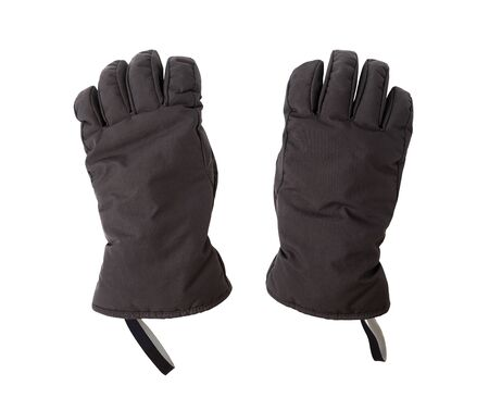 Pair of black ski gloves isolated on white background. Protective winter sport accessories