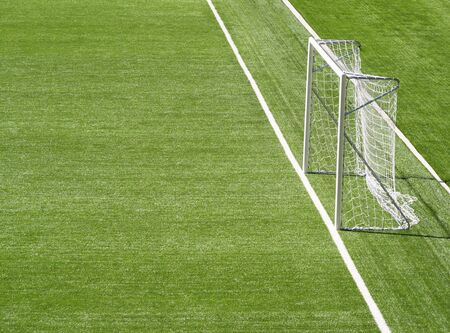 Portable goal post at football pitch background with copy space