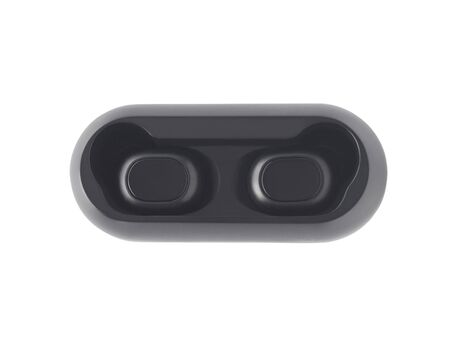 Top view of wireless earbuds in charging case isolated on white background