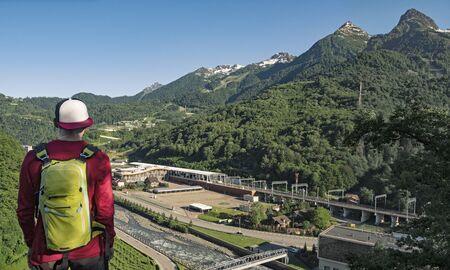 Man looking at Rosa Khutor resort and mountains in Krasnaya polyana (Sochi, Russia)