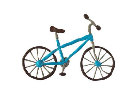 Plasticine bicycle isolated on white background Stockfoto