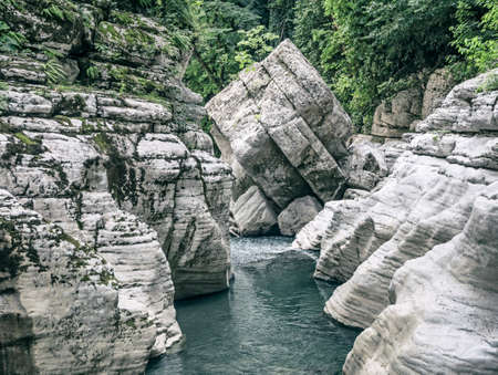 Canyon White Rocks with river water and big stone roadblock in Sochi, Russia