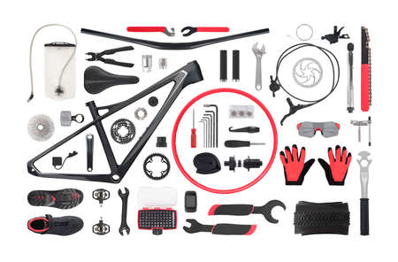 Flat lay of bicycle components, tools and equipment isolated on white background.