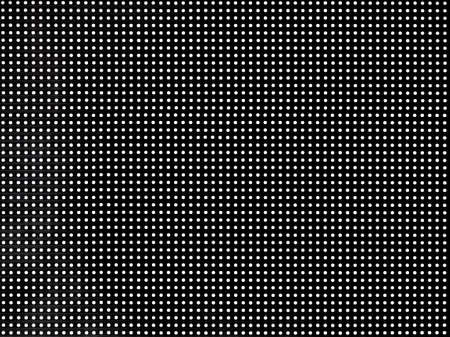 LED screen with digital dots on black background. Display texture
