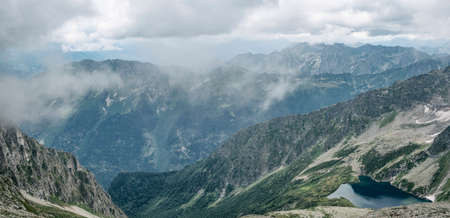 Panoramic view of Imereti Lake Gumanoids at Karachay-Cherkess mountains background. Travel destination in Caucasus, Russia