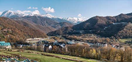 Panoramic view of Caucasus mountains ridge, Esto-Sadok and Krasnaya Polyana villages. Famous place in Sochi, Russia