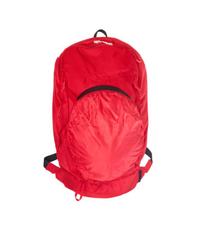 Front view of red ski backpack with helmet in holder isolated on white