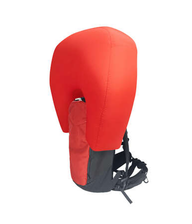 Side view of red inflated avalanche airbag backpack isolated on white background 免版税图像