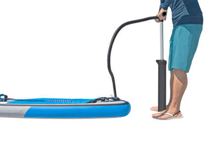 Man inflating stand-up paddle board and isolated on white background