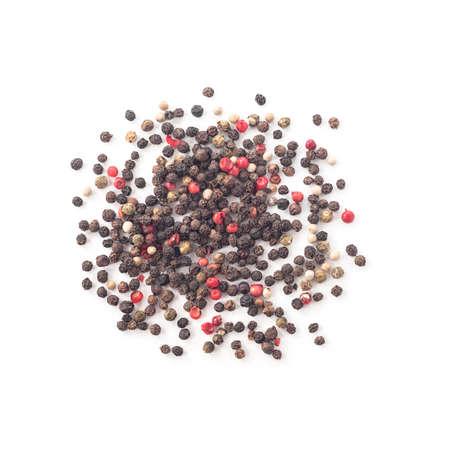 Heap of whole black, white, green and pink peppercorns 免版税图像