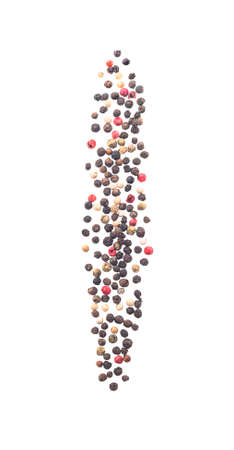 Whole black, white, green and pink peppercorns falling and isolated on white