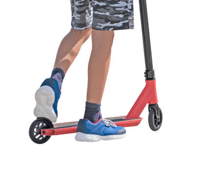 Boy riding kick scooter and isolated on white background