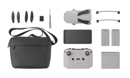 Top view of drone and flight accessories isolated on white background