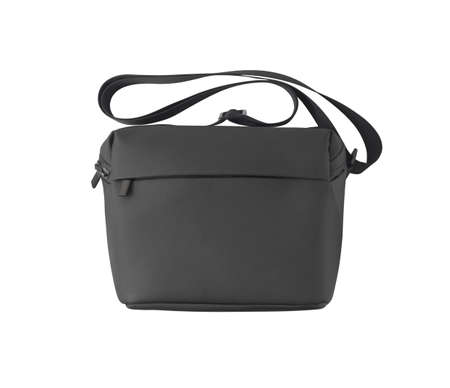 Black shoulder bag with strap isolated on white background. Leather accessory