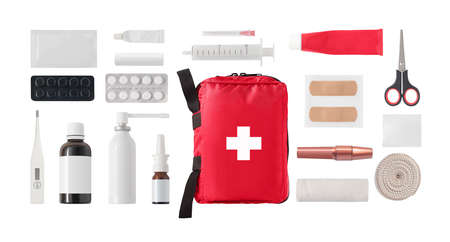 Flat lay of medical first aid kit with medicine, drugs and bandages isolated on white background