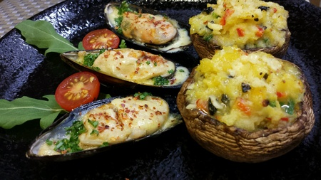 mussels: Stuffed portobello mushroom with cheese baked mussels Stock Photo