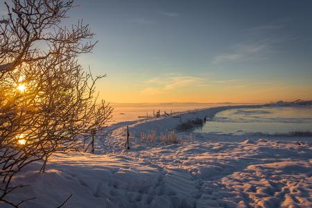 Winter landscape frozen ocean and sunrise