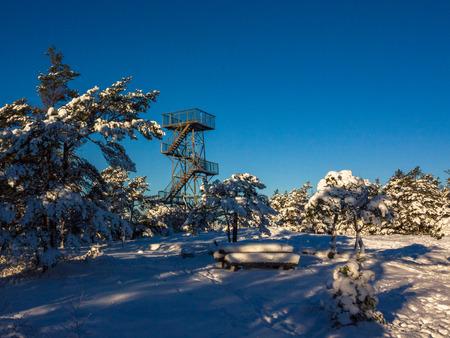 Vetatoppen, viewpoint tower in Fredrikstad, Norway. Winter, sun, snow. Stock Photo