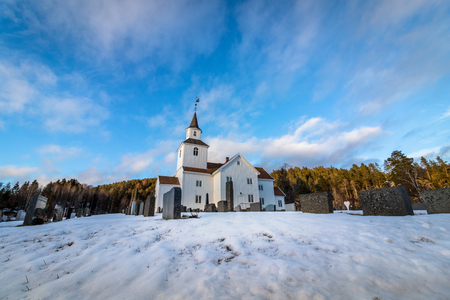 Church in winter with snow and blue sky in Iveland Norway Stock Photo