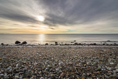 oslo: Ocean view from the pebble shore in the island of Jomfruland in Jomfruland National Park, Kragero, Norway Stock Photo