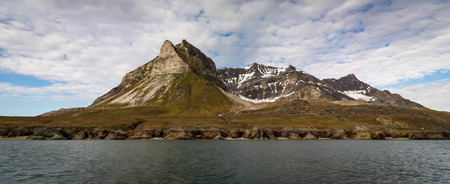 Alkehornet, Alkhornet, Alkepynten. Bird mountain in Svalbard, Norway. Panorama