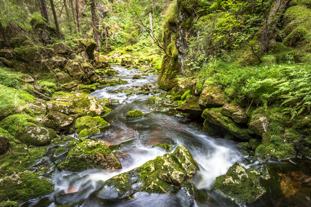Water flow in a stream, long exposure Stock Photo