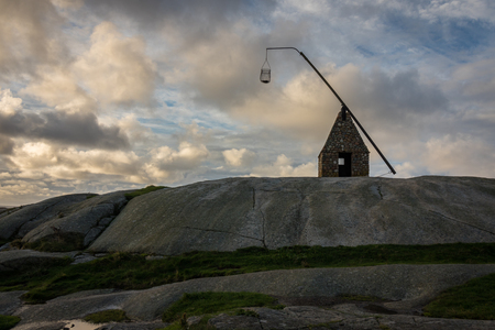 ende: Old lighthouse made of rocks, at Verdens Ende in Vestfold Norway Stock Photo