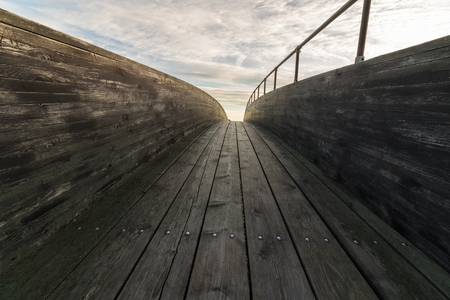 ende: wood bridge with clouds and sky above