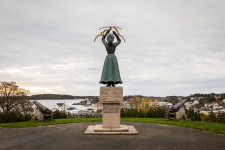Grimstad, Norway - October 31 2017: Statue standing on Kirkeheia. Memory of world war II victims, from 1948. Made by Staale Kyllingstad. Editorial