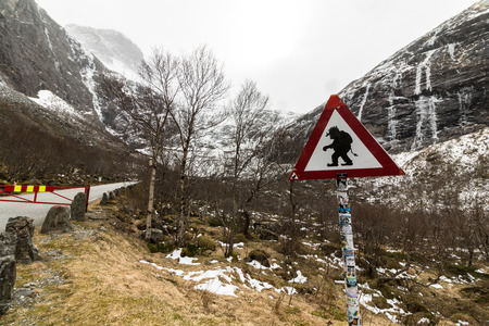 Funny troll warning sign at the parking place at the road Trollstigen, Norway. 스톡 콘텐츠