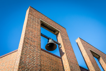 The bell at the chapel and crematorium in Oddernes, blue sky above, Kristiansand, Norway Stock Photo